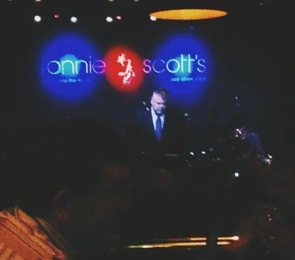 Jeff Williams, bandleader of the Swamp Dogs, in the spotlight, performing with the band recently at Ronnie Scott's.