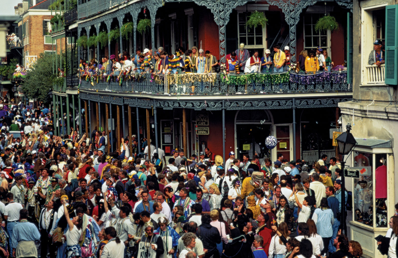 Mardi Gras in New Orleans. A full Street of dancers on the Street and on balconies.