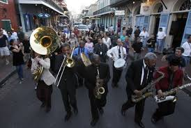 New Orleans Jazz Band marching and playing down a street in the city